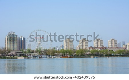 Tianjin,China - April 7,2016 : Panoramic Cityscape of ferris wheel in Water park(shuishang park),this park is the one of popular tourist attraction in Tianjin city.