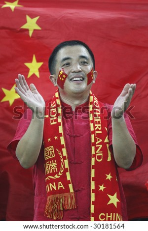 TIANJIN, CHINA - AUGUST 6:  A fan shows his support for the Chinese women's soccer team prior to a match between China and Sweden at the Beijing Olympic Games August 6, 2008 in Tianjin, China. - stock photo