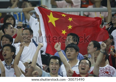 TIANJIN, CHINA - AUGUST 6:  Chinese fans celebrate a goal during a soccer match between China and Sweden at the Beijing Olympic Games soccer tournament August 6, 2008 in Tianjin, China.