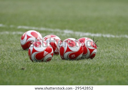 TIANJIN, CHINA - AUGUST 7:  Soccer balls on the field during warm ups prior to a match between the USA and Japan at the Beijing Olympic Games soccer tournament August 7, 2008 in Tianjin, China. - stock photo