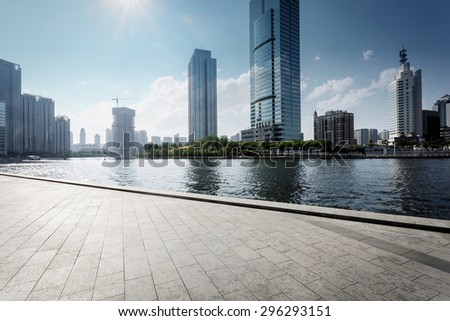 Tianjin,China-May 22,2015:modern building exterior with brick road floor in Tianjin at riverbank - stock photo