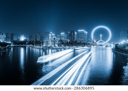 tianjin cityscape at night ,skyline and light trails on haihe rive - stock photo