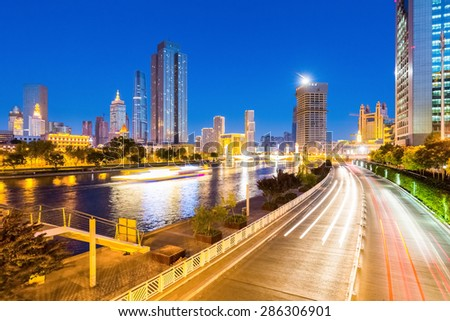 tianjin night scene of haihe river and city road  , China