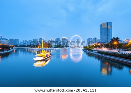 tianjin scenery of beautiful haihe river in night falls - stock photo
