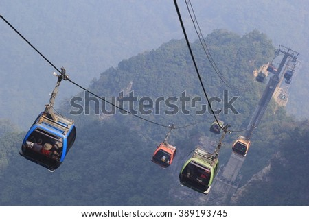 Tianmen Shan cable car is the longest cable car ride in the world, covering a distance of 7,455 meters. The car runs from Zhangjiajie downtown up to Tianmen Shan, China - stock photo