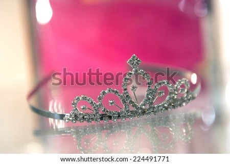 Tiara for children on the glass window
