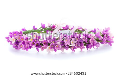tiara of artificial flowers isolated on white background - stock photo