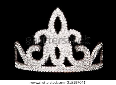 tiara on a black background - stock photo