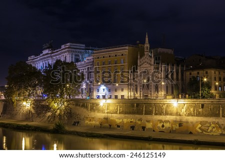 Tiber river embankment in evening in Rome