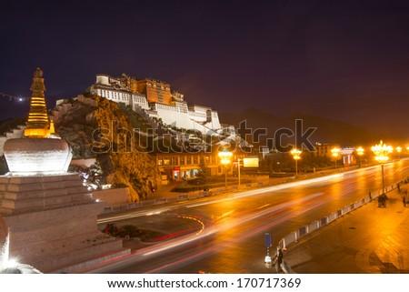 Tibet's Potala Palace at night in China - stock photo