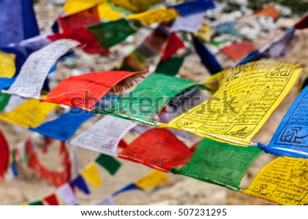 "Tibetan Buddhism prayer flags (lungta) with ""Om Mani Padme Hum"" Buddhist mantra prayer. Leh, Ladakh, Jammu and Kashmir, India"