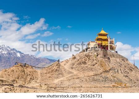Tibetan Buddhist monastery on mountain in Leh Ladakh, India.  - stock photo
