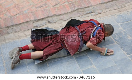 Tibetan committing pilgrimage in Kathmandu (Nepal) - stock photo