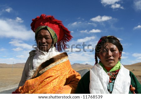 Tibetan couple on the road