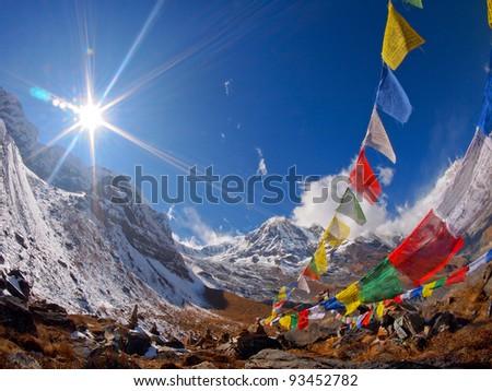 Tibetan Flags at Annapurna Base Camp 4200m (Himalaya, Nepal) - stock photo