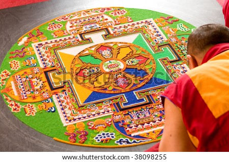 Tibetan mandala tilt from coloured sand - stock photo