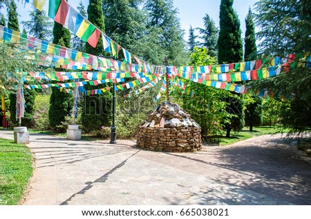 Tibetan pile of stones with colorful Tibetan prayer flags in the Tibetan village which is located at Yunnan Nationalities Village, China.