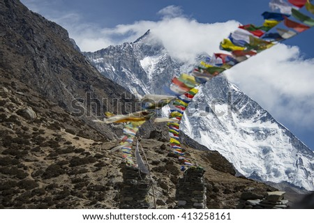 tibetan Prayer flag and stupa  on the top of Chukung ri with Lhotse (8516m) - from Dingboche Mt. Everest region Nepal
