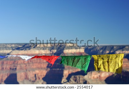 Tibetan prayer flags above Grand Canyon on sunny day - stock photo