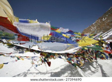 Tibetan praying flags floating on the Thorong-la pass at 5416m
