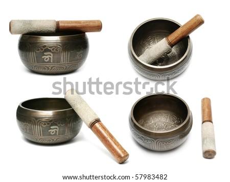 Tibetan singing bowl set isolated on white - stock photo