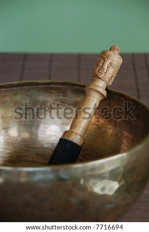 Tibetan singing bowl with felt mallet - stock photo