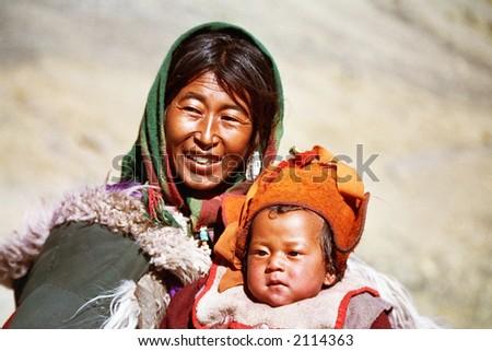 Tibetian mother & son - stock photo