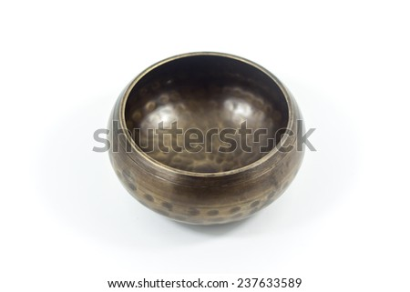 Tibetian singing bowl isolated on white - stock photo