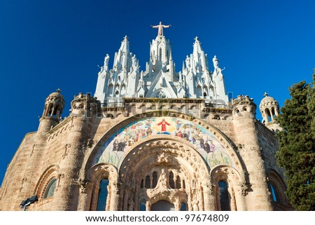 Tibidabo church on mountain in Barcelona with christ statue overviewing the city - stock photo