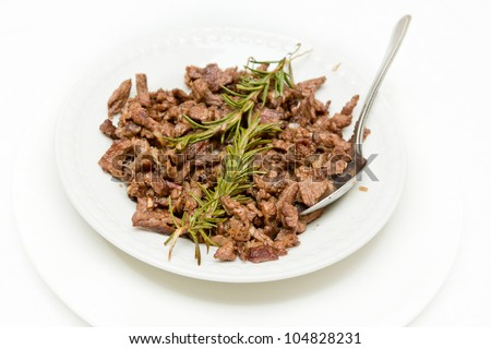 Tibs, Traditioal Ethiopian cusine which is saut�©ed meat and onions served with rosemerry leaves - stock photo