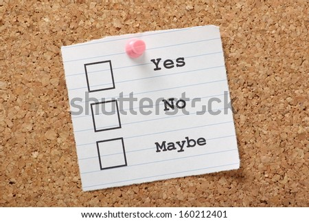 Tick boxes for Yes, No and Maybe on a scrap of lined paper pinned to a cork notice board. - stock photo
