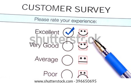 Tick in excellent checkbox on customer service satisfaction survey form - stock photo