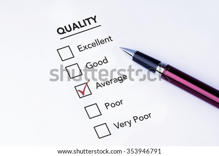 Tick placed in average check box on quality service satisfaction survey form with a pen on isolated white background. Business concept survey. - stock photo