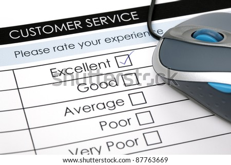Tick placed in excellent check box on customer service satisfaction survey form with computer mouse - stock photo