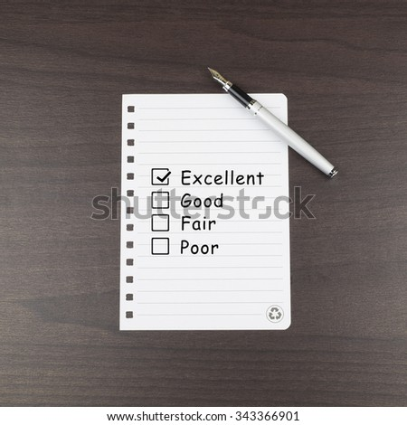 Tick placed in excellent checkbox on customer service satisfaction  - stock photo