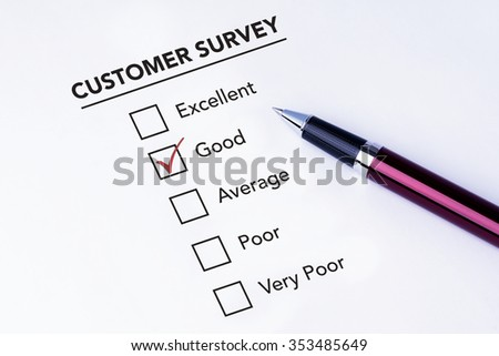 Tick placed in good check box on customer service satisfaction survey form with a pen on isolated white background. Business concept survey. - stock photo