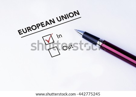 Tick placed in In check box on European Union form with a pen on isolated white background. Brexit UK EU referendum concept