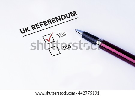 Tick placed in Yes check box on UK Referendum form with a pen on isolated white background. Brexit UK EU referendum concept