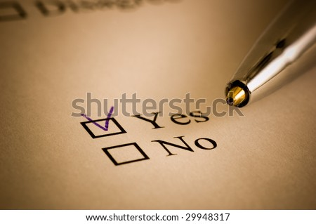 Tickbox with a blue cross on YES an a golden ballpointer - stock photo