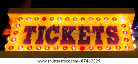 Tickets - Amusement park ticket booth sign at night - stock photo