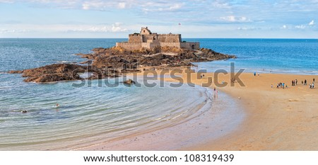 Tidal beach and medieval castle Petite Be in atlantic city Saint Malo, Brittany, France - stock photo