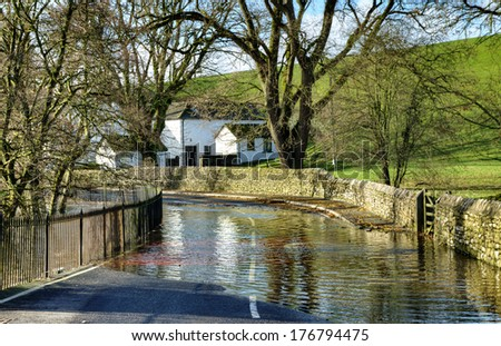Tidal Flooding on a country road - stock photo