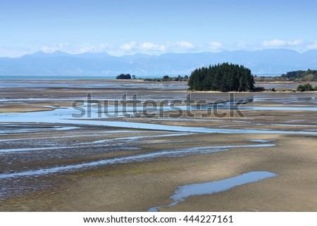 Tidal mud flats - coastal wetlands at Tapu Bay, South Island, New Zealand. - stock photo