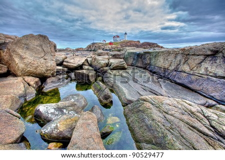tidal pool before lighthouse - stock photo
