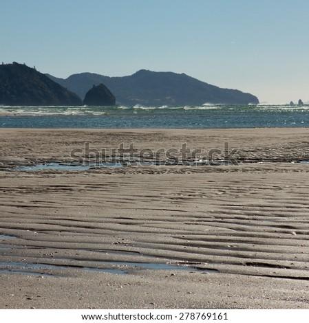 tidal pools on the shore at Matarangi Beach, Coromandel Peninsula, New Zealand  - stock photo