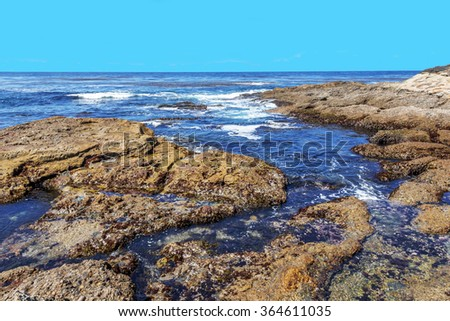 Tidal pools,rock and geological formations along the rugged Big Sur coastline, near Monterey, CA. on the California Central Coast. - stock photo