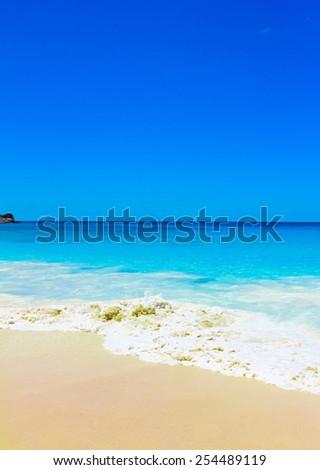 Tide Splashing Beach  - stock photo