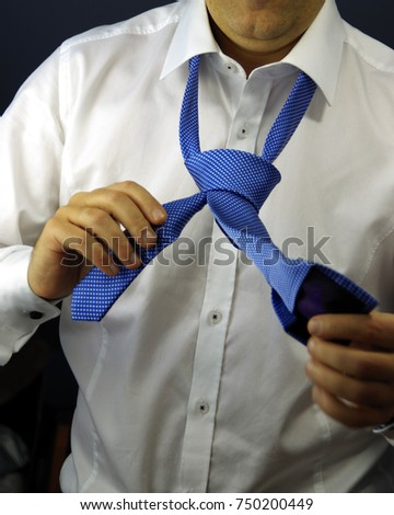 Cravat knot stock images royalty free images vectors shutterstock tie a tie corporation career and business concept close up of man in white ccuart Choice Image