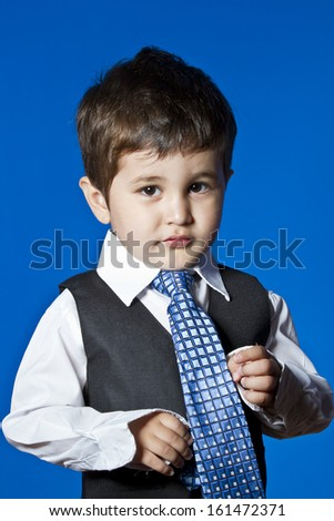 Tie, cute little boy portrait over blue chroma background