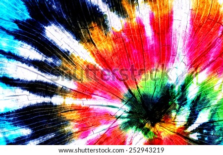 tie dye pattern with tree stump. - stock photo